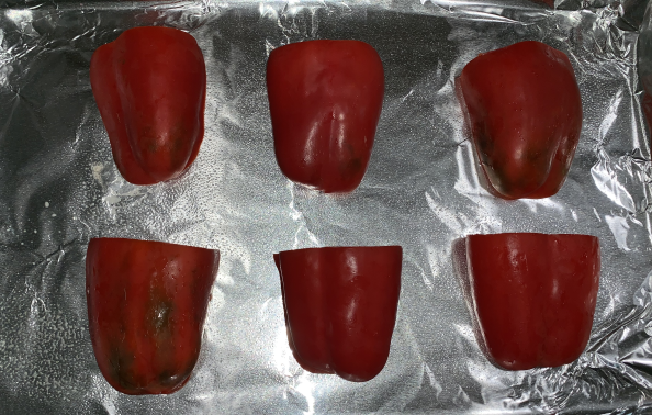 Place cut red peppers on prepared baking sheet in order to roast red peppers